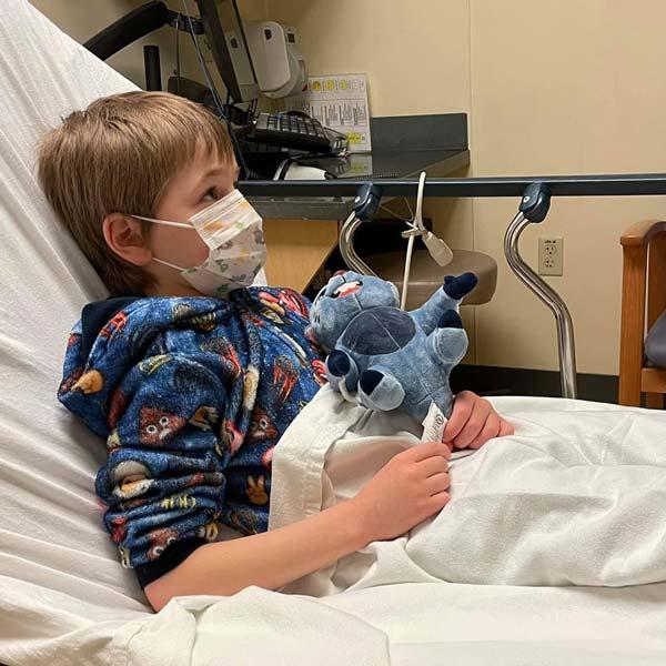 Pediatric cancer survivor Aiden in the hospital