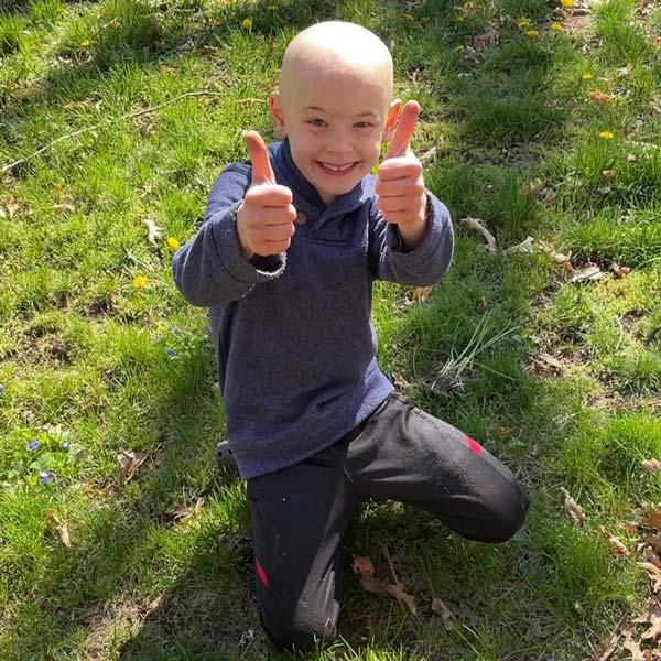 Pediatric cancer survivor Aiden outside